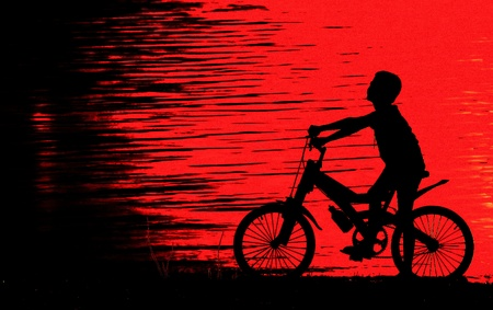 Boy on BMX silhouette background photo