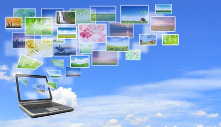 find images videos: Multimedia concept with modern laptop on green field.
