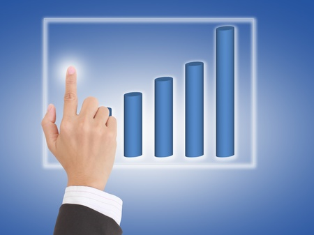 current account: hand pushing a business graph Stock Photo
