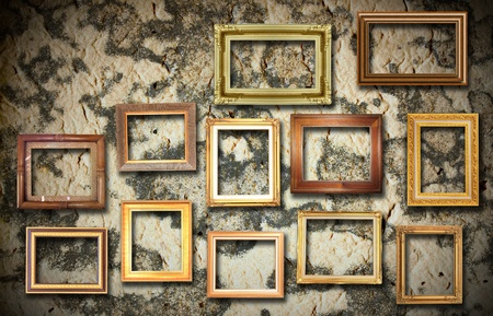 abandoned room: golden frame on old wall Stock Photo