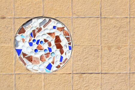 mosaic wall decorative ornament from ceramic broken tile photo