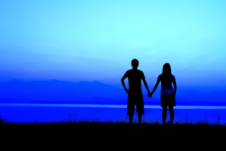 Couple silhouette  at sunset Stock Photo