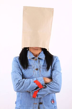 Woman with paper bag on head photo