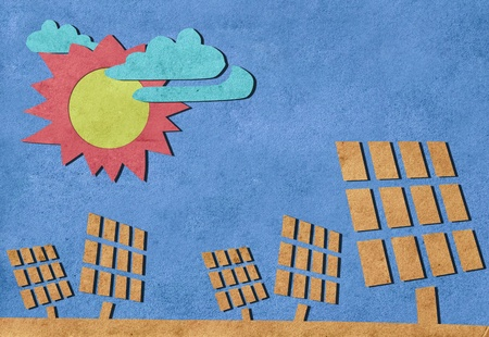 Solar cells station recycled paper craft stick on paper background  photo