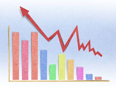 graph showing rise in profits made with recycled paper craft stick photo
