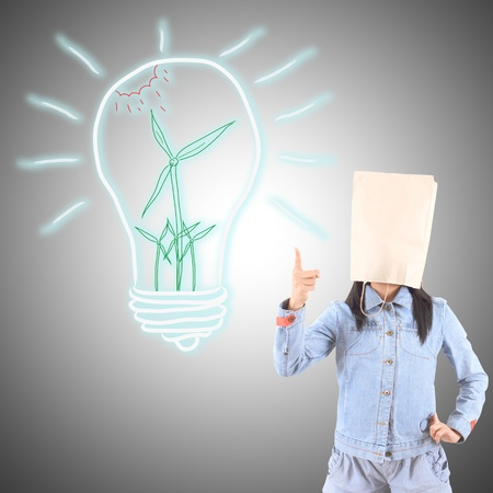 Businesswoman drawing and idea lamp photo