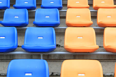 plastic, yellow and blue, new chairs in stadium  photo