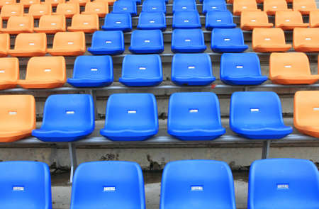plastic, yellow and blue, new chairs in stadium. photo