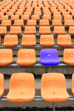 Empty stadium chairs, representing individuality photo