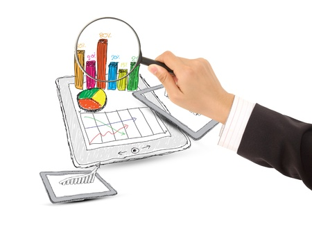 computer tablet showing a spreadsheet with  charts photo