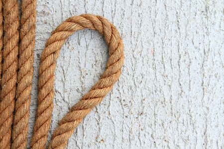 fixed line: ship ropes and knot on   background texture
