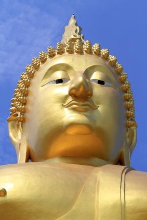 venerate: Big Buddha image on blue sky background