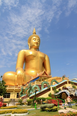 Big Buddha image on blue sky background photo