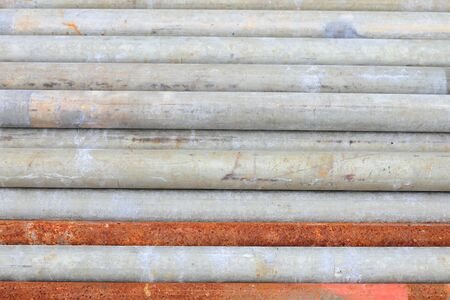 group of metal pipes on shelf photo