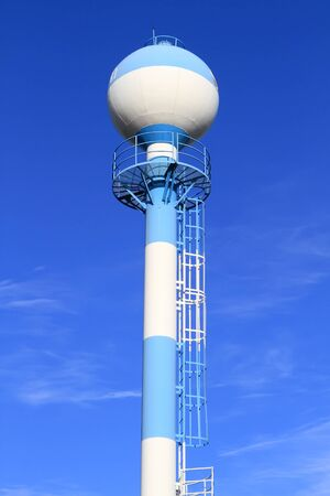 wody wieży: Water tower against blue sky