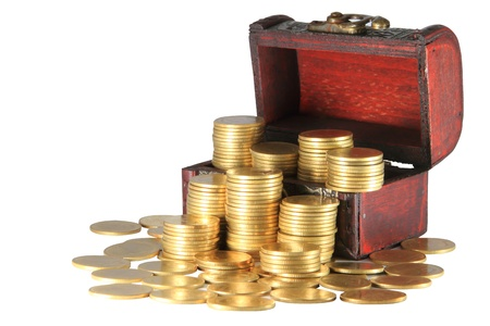 A wooden ancient chest full of money Stock Photo - 14062116