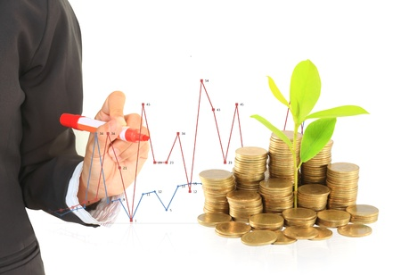 Financial graph with coins Stock Photo - 14208477