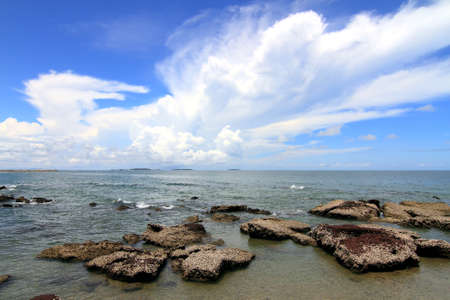 Tropical beach with stone and sky photo
