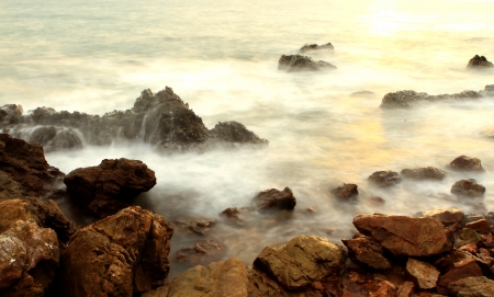 Beautiful seascape. Sea and rock at the sunset photo