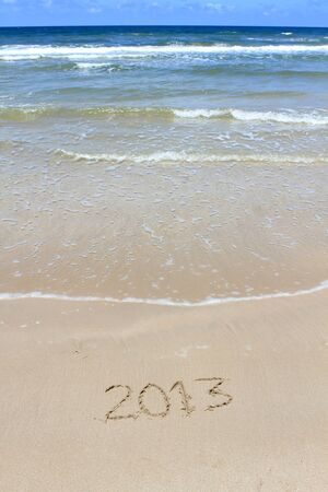2013 Happy New Year on sea beach photo