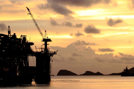 shiprepair: Silhouette of dock- and shipbuilding company at sunset Stock Photo