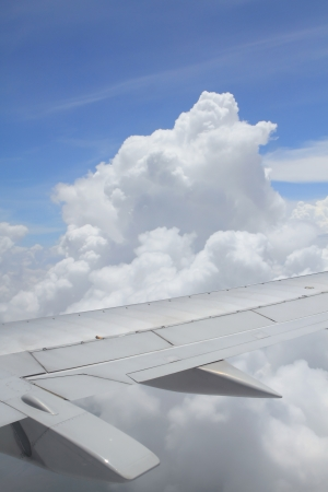 wing of the airplane under the clouds photo