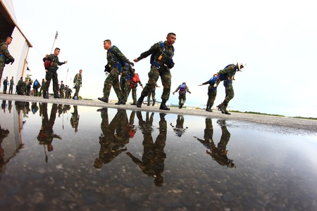 Sattaheep - SEPTEPBER 12: Thai navy parachute team prepare for jump for show in Sunset parade on Sep. 12, 2012 in Sattaheep, Chonburi, Thailand