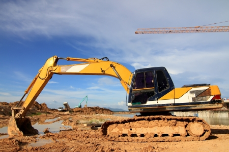 truckload: excavator loader machine during earthmoving works outdoors at construction site