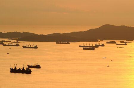 image of Cargo ship at twilight time. photo