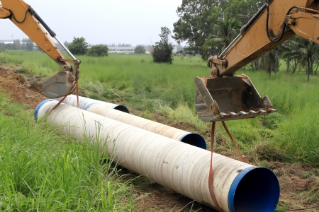Specialized equipment for placing large diameter pipe in a trench