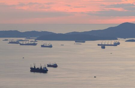 image of Cargo ship at twilight time. photo