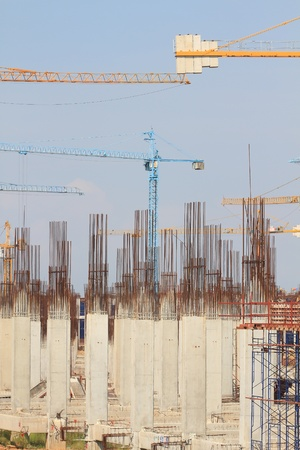 Construction site with enforced concrete steel frames rising up photo