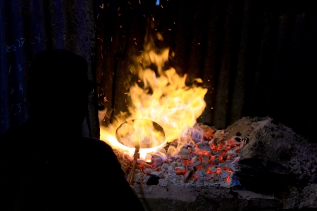 forge: forge fire in blacksmiths where iron tools are crafted Stock Photo