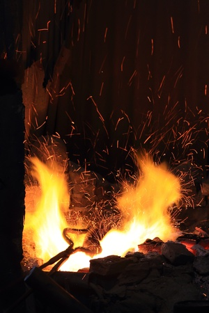 forge fire in blacksmiths where iron tools are crafted photo