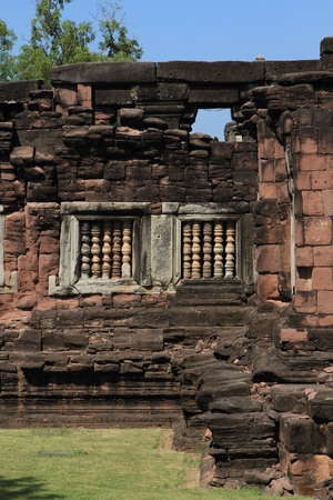 Sand stone window of the historical castle in Thailand.