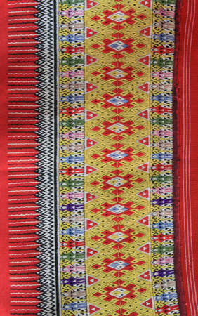 Closeup texture of thai style fabric weave hand-woven photo