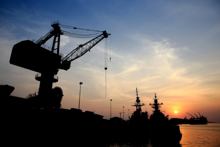 Cranes in dockside at sunset photo