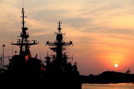 a battleship: battleship with sunset behind