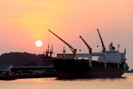 Cargo ship in the harbor at sunset Stock Photo - 17871414
