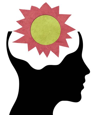 Human head silhouette with paper sun on the brain photo