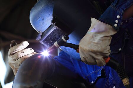 skilled: welder at factory work