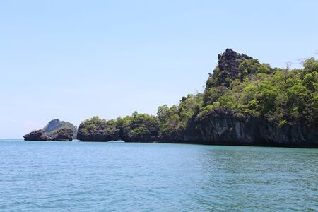 Tropical sea island rock, Thailand krabi shore line, island in sea photo