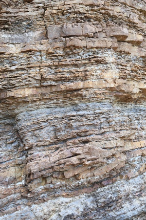 stratified: Layered rock on high steep sea bank Stock Photo