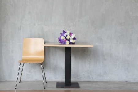 modern interior table and chairs with flowers. photo