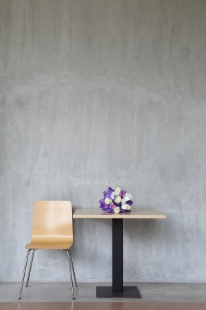 minimal: modern interior table and chairs with flowers.