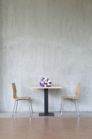 two chairs: modern interior table and two chairs with flowers.