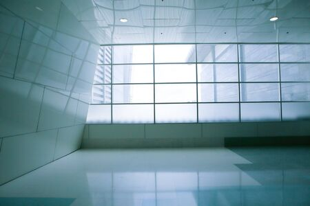spacious: White empty room with shadow from a large window Stock Photo
