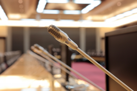 before a conference, the microphones in front of empty chairs Stock Photo - 20939815