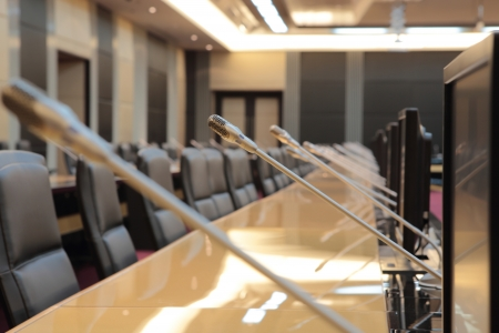 news room: before a conference, the microphones in front of empty chairs