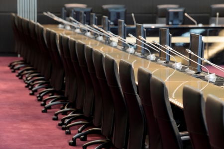 before a conference, the microphones in front of empty chairs Stock Photo - 20959497
